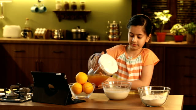 ms girl preparing orange juice in kitchen / delhi, india - one girl only stock videos & royalty-free footage