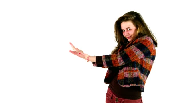Girl presenting showing or pointing to something on a white background