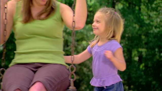 girl pushing woman on a swing - see other clips from this shoot 1428 stock videos & royalty-free footage