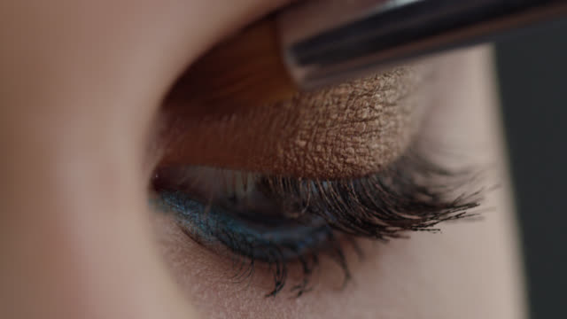 girl puts eye shadow. fashion video. make-up. - stage make up stock videos & royalty-free footage