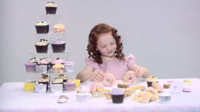 girl putting doughnuts in front of eyes - doughnut stock videos & royalty-free footage