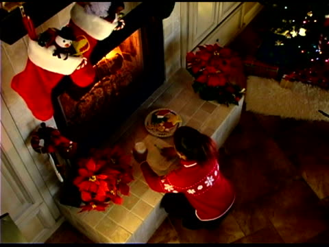 girl putting note to santa and christmas cookies on fireplace - see other clips from this shoot 1407 stock videos and b-roll footage