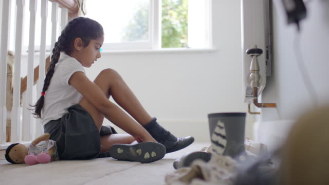 girl putting on her shoes at home - uniform stock videos & royalty-free footage