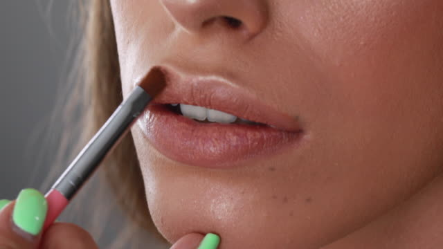 girl putting on lip gloss with a small brush - make up stock videos & royalty-free footage