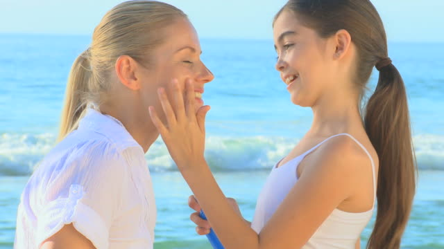 girl putting suncream on her mother's face / cape town, western cape, south africa - sun cream stock videos and b-roll footage