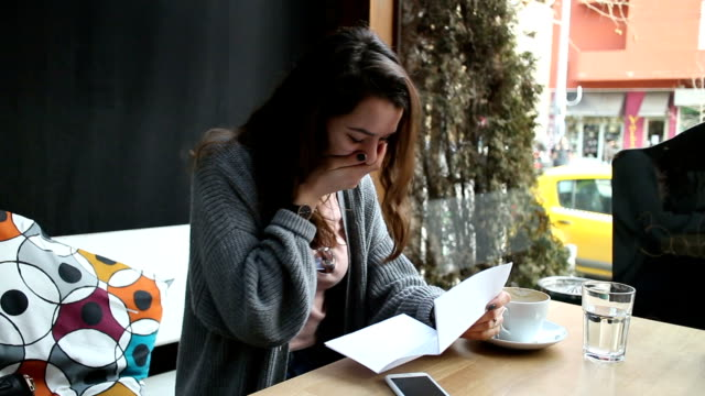 Girl reading a letter in her free time