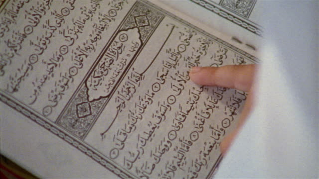 cu, girl (10-11) reading book on religion school, close-up of open book, cairo, egypt - non western script stock videos & royalty-free footage