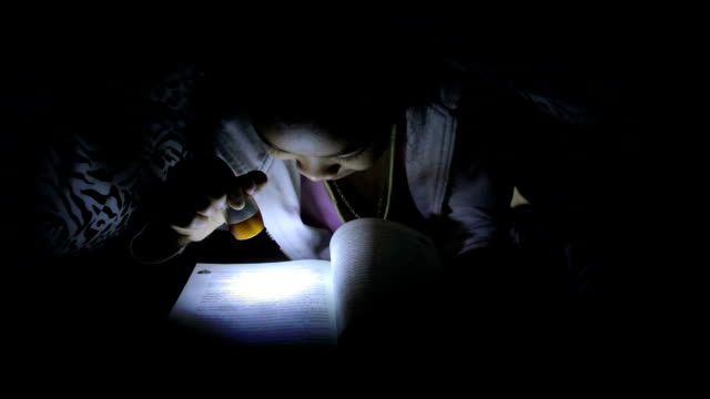 girl reading book under the blanket - electric torch stock videos & royalty-free footage