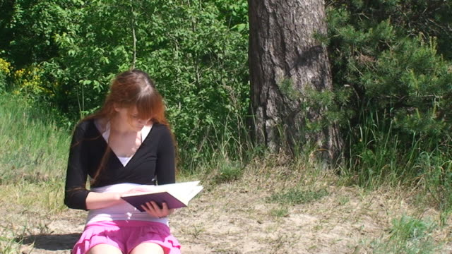girl reading book - mini skirt stock videos & royalty-free footage