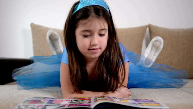 girl reading book - magazine publication stock videos & royalty-free footage