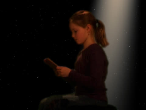 girl (8-10) reading book - digital enhancement stock videos and b-roll footage