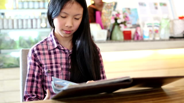 girl reading food menu in restaurant - mack2happy stock videos and b-roll footage