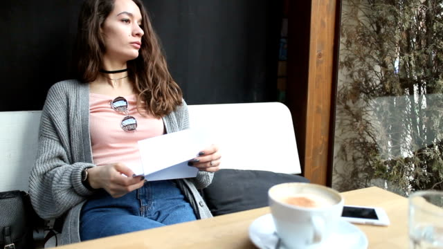 girl reading letter with bad news - relationship breakup stock videos & royalty-free footage