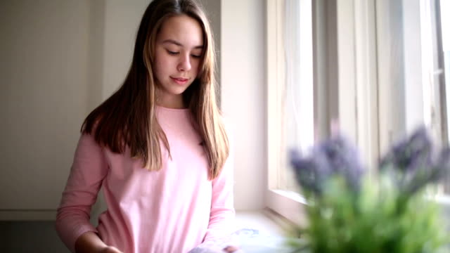 girl reading magazine at home - magazine publication stock videos & royalty-free footage
