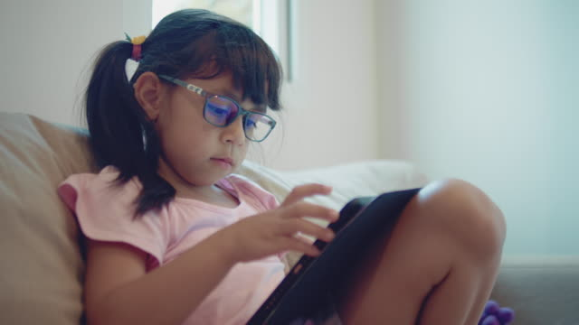 girl reading on tablet - e book stock videos & royalty-free footage