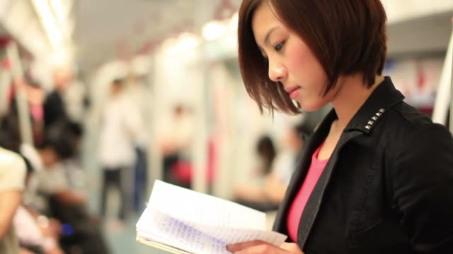 girl reading on the train - selective focus stock videos & royalty-free footage