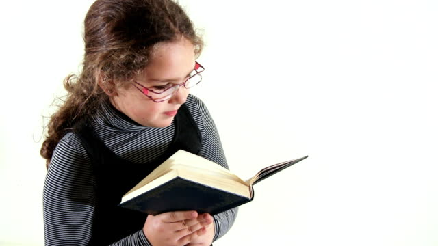 girl reading (hd) - hardcover book stock videos and b-roll footage