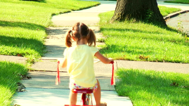 girl rides tricycle away - tricycle stock videos & royalty-free footage