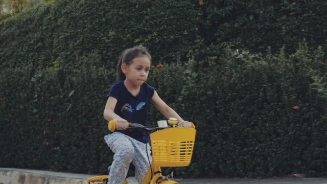 girl riding a bicycle - children only stock videos & royalty-free footage