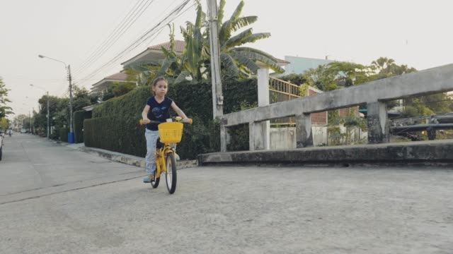 girl riding a bicycle - yellow stock videos & royalty-free footage