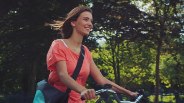 girl riding bike - riding stock videos & royalty-free footage