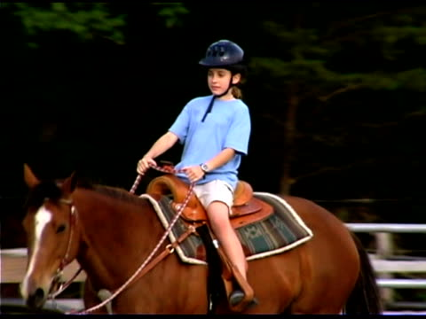 girl riding horseback at ranch - recreational horse riding stock videos and b-roll footage