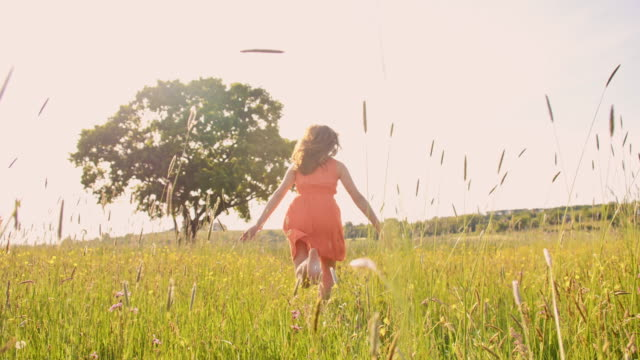 TS Girl running barefoot in the grass