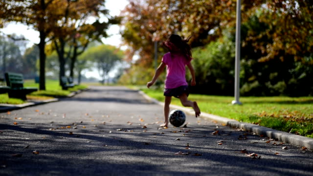 a girl running in a park with a soccer ball. - one girl only stock videos & royalty-free footage