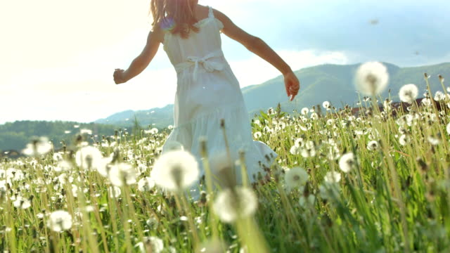 super slo-mo girl running in the grass - grass area stock videos & royalty-free footage