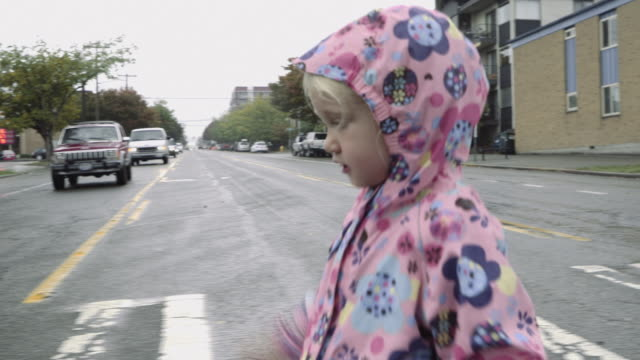 girl running in the rain - complete sequence - sidewalk stock videos & royalty-free footage