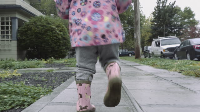 girl running in the rain - seattle stock videos & royalty-free footage