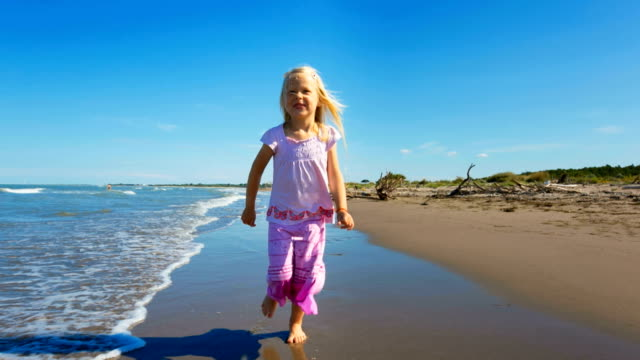 Girl running on sandy beach