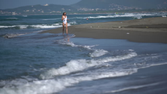 girl running on the beach - one piece swimsuit stock videos and b-roll footage