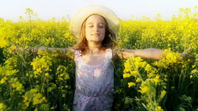 HD SLOW MOTION: Girl Running Through Field With Open Arms