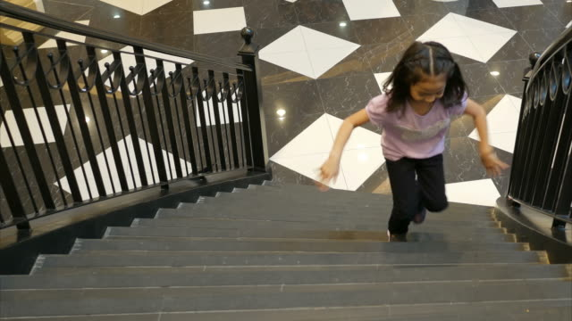 girl running up on stair - schoolgirl stock videos and b-roll footage