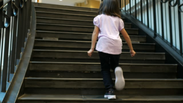 girl running up on stair - staircase stock videos and b-roll footage