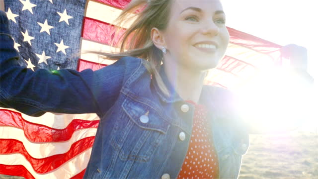 Girl running with a US flag concept