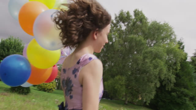 girl running with balloons - floral pattern stock videos & royalty-free footage