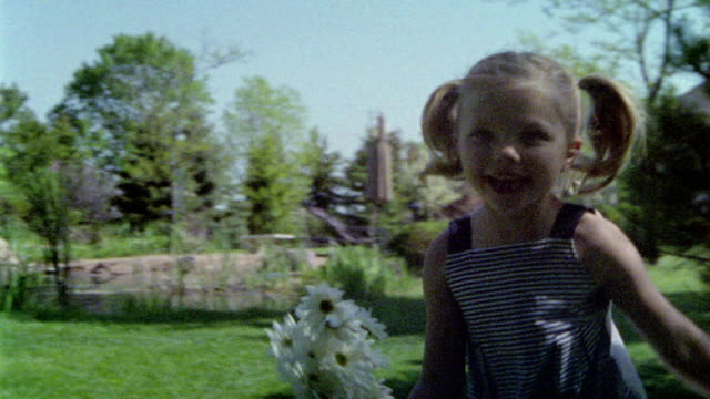 ms slo mo girl running with bunch of daisy / appleton, wi, usa - appleton video stock e b–roll