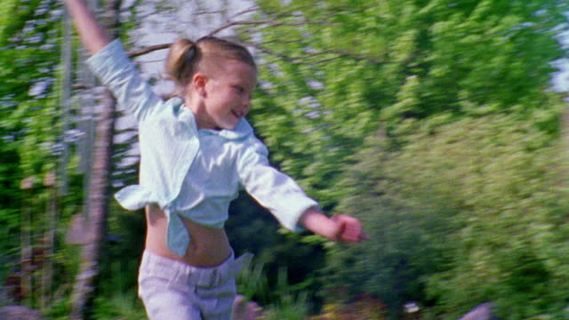 ws pan girl running with multicolored kite in lawn / appleton, wi, usa - appleton video stock e b–roll