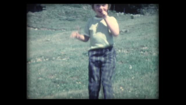 1962 girl runs down mountain side to camera - field stock videos & royalty-free footage