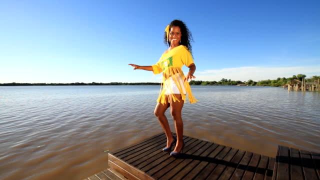 Girl samba on boat deck