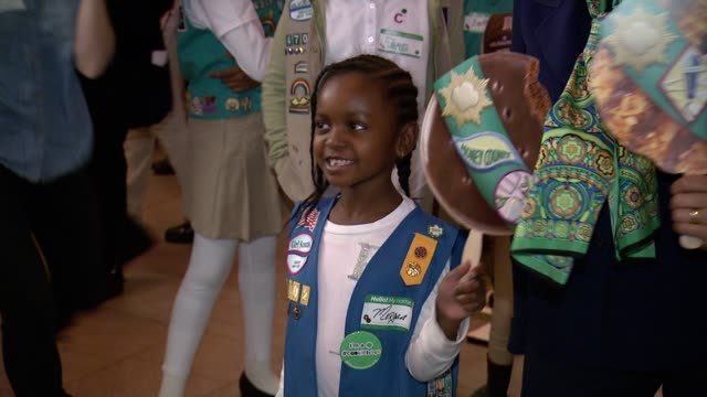 girl scouts at girl scouts kicks off national girl scout cookie weekend at grand central terminal at grand central terminal on in new york city - biscuit stock videos & royalty-free footage