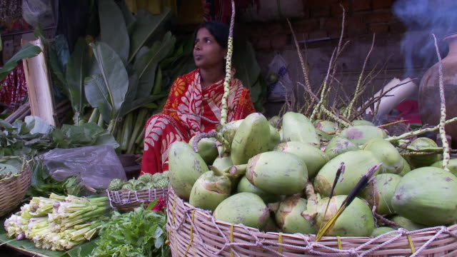a girl sells bundles of bananas leaves in a fresh produce market in calcutta. - incense stock videos & royalty-free footage