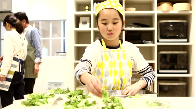 girl serving lettuce on a plate - 8 9 years stock videos & royalty-free footage