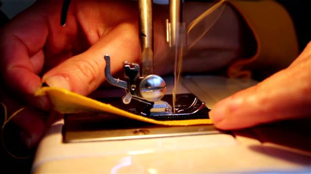 Girl sews a zipper