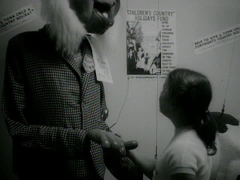 girl shakes hands with a large string puppet of a farmer at the boys and girls exhibition at olympia. - exhibition stock videos & royalty-free footage