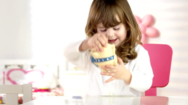 hd dolly: girl shaking coins out of a piggy bank - unloading stock videos & royalty-free footage