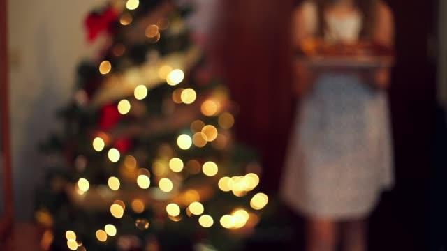 girl showing a big christmas sweet. - parte de una serie video stock e b–roll