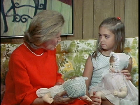1971 montage girl showing dolls to grandmother, mother becoming upset, los angeles, california, usa, audio   - domestic room stock videos & royalty-free footage